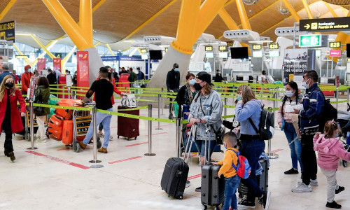 Vaccinated passengers in an airport, awaiting their flights